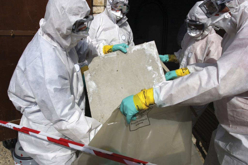 Four people removing Asbestos
